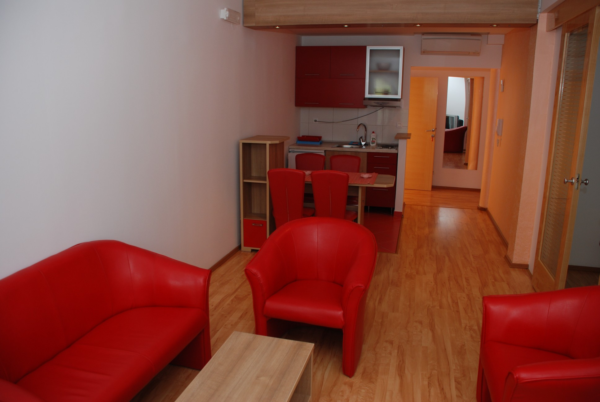 Red apartment livingroom Springs apartments Montenegro