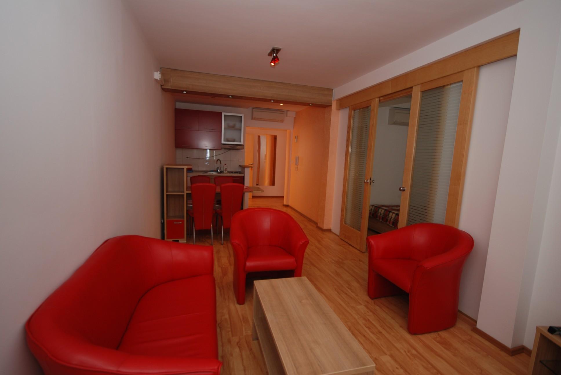 Red apartment livingroom Springs apartments Montenegro