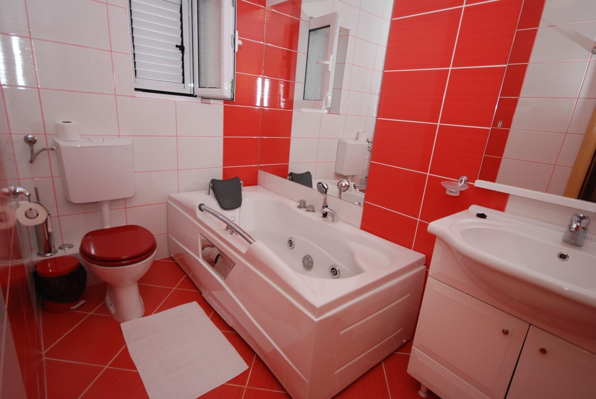 Red apartment bathrooom Springs apartments Montenegro