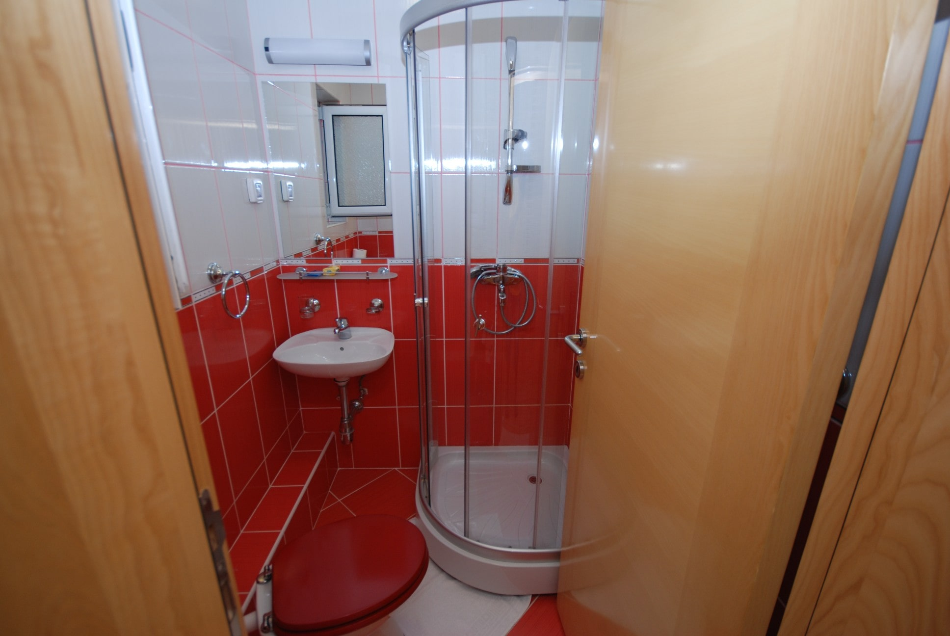 Red apartment bathrooom Springs apartments Montenegro
